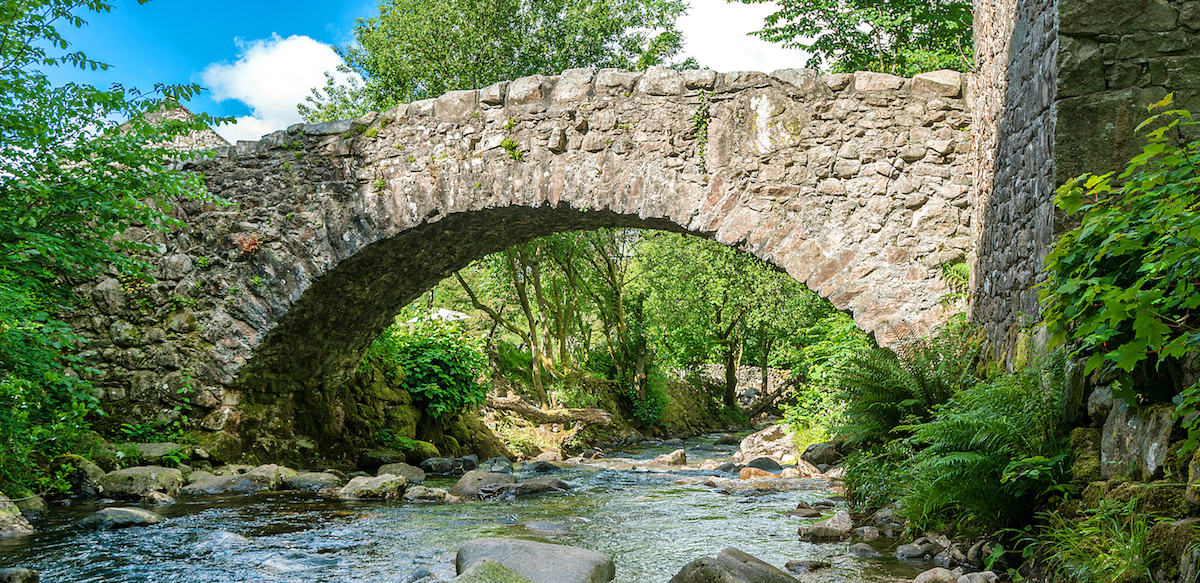 The bridge over Whillan Beck, with our namesake cottage in the background