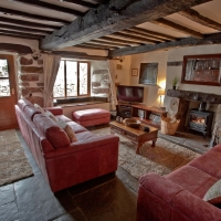 Farmhouse Oak Beamed Living Room with cosy woodburner