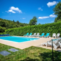 Private heated outdoor pool with safety fence and alarm