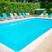 Sun Loungers beside our heated swimming pool